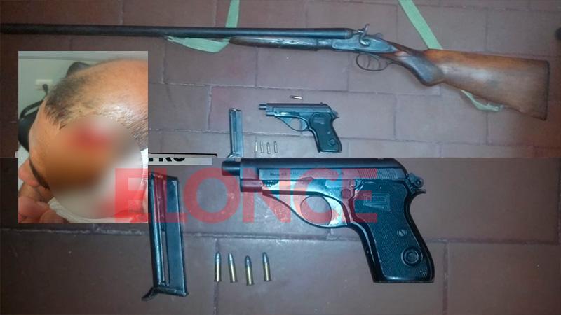 Las armas secuestradas y el corte que sufrió el policía